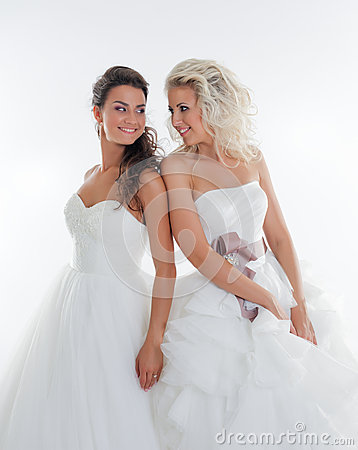 Beautiful young brides smiling at each other