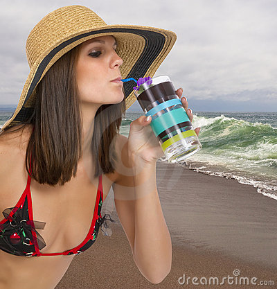 Beautiful young brunette female at the beach