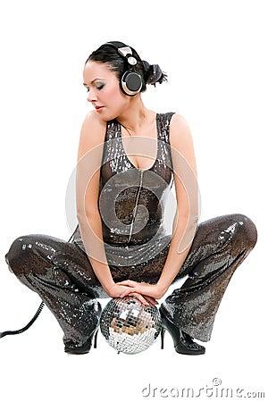 Beautiful young brunette in headphones