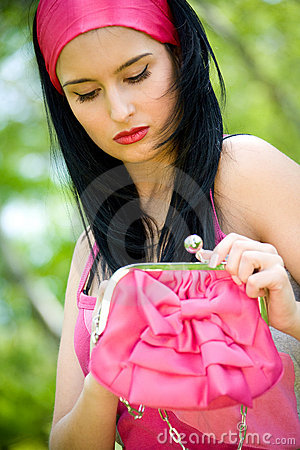 Beautiful young brunette with pink purse