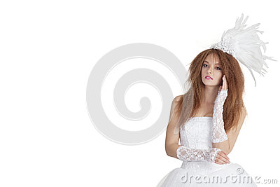 Beautiful young brunette in wedding gown looking away over white background