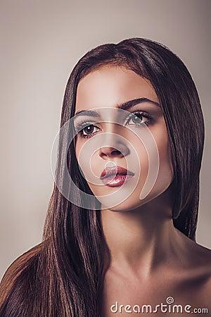 Beautiful young brunette woman glamour portrait Close up face Long hair