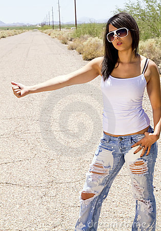 Free Beautiful Young Brunette Woman Hitchhiking Royalty Free Stock Photo - 14551235