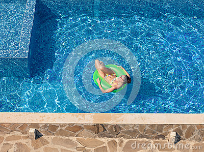 Beautiful Young Brunette Woman With Inflatable Circle In Swimmin Stock Photo Image 63606472