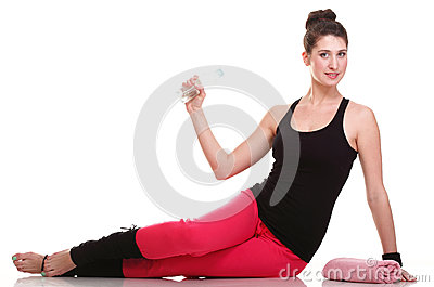 Beautiful young brunette woman stretching muscles arms isolated