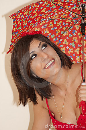 Beautiful young brunette woman with umbrella