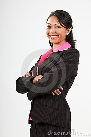 Beautiful young business woman arms folded smiling