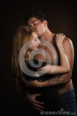 Free Beautiful Young Couple Hugging And Kissing Isolated On Black Background. Stock Image - 37175981
