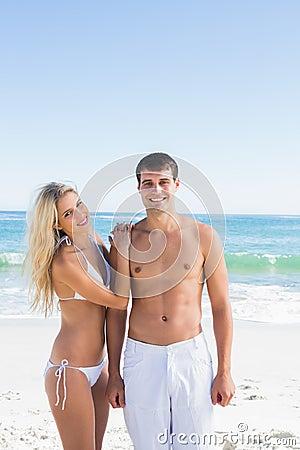 Beautiful young couple smiling at camera