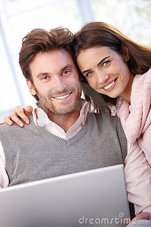 Free Beautiful Young Couple Using Laptop Smiling Royalty Free Stock Image - 21229396