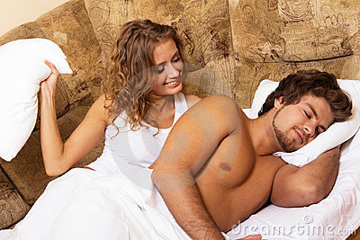 Beautiful young couple waking up