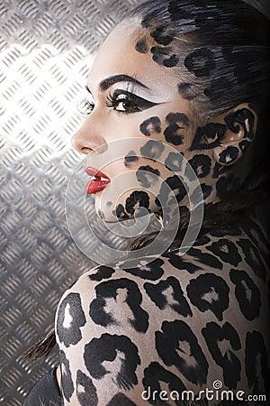 Beautiful young european model in cat make-up and bodyart