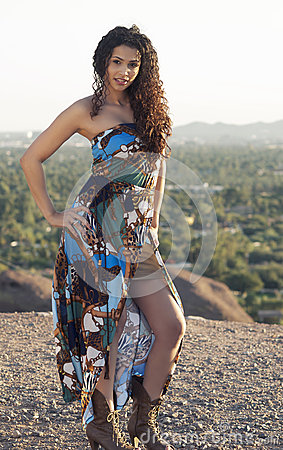 Beautiful young exotic woman with curly hair