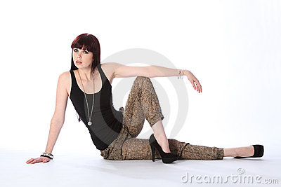 Beautiful young fashion model sitting on floor