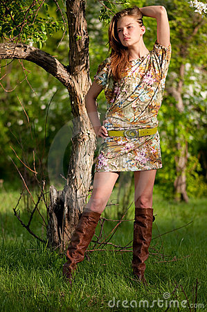Beautiful young fashion woman posing outdoor