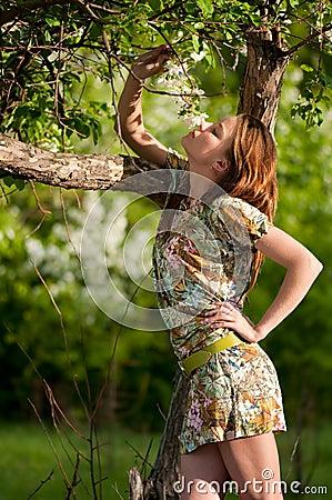 Beautiful young fashion woman posing outdoor