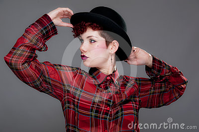 Beautiful young female in bowler hat and shirt