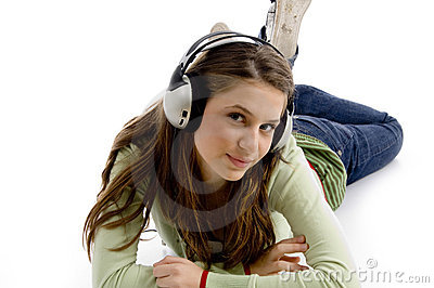 Beautiful young female enjoying music