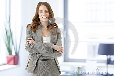 Beautiful young female executive smiling
