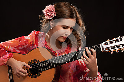 Beautiful young female guitar player