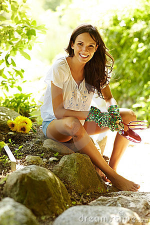 Beautiful young female holding gardening tools
