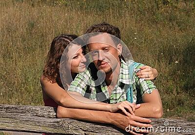 Beautiful young female hugging her boyfriend