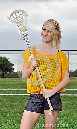 Beautiful young female lacrosse player