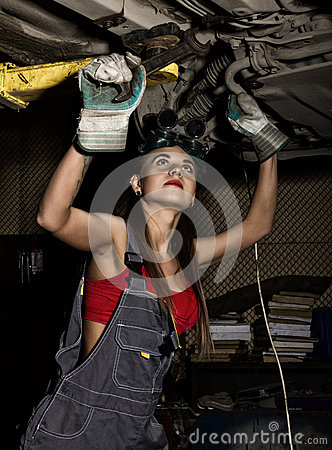 Free Beautiful Young Female Mechanic Inspecting Car In Auto Repair Shop. Sexy Mechanic Stock Images - 71302444
