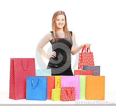 Beautiful young female posing with shopping bags