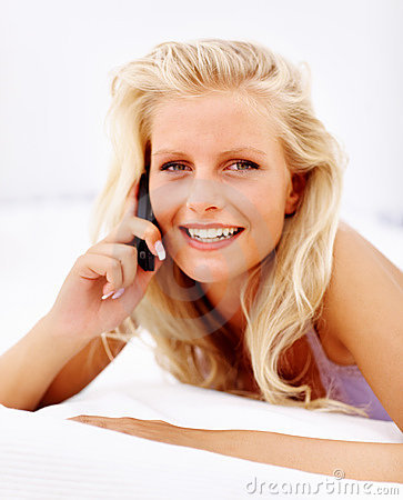 Beautiful young female speaking on the cellphone