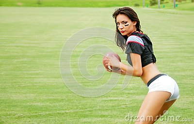 Beautiful young football woman