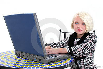 Beautiful Young Girl In Business Suit Working On Laptop