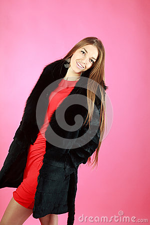 Beautiful young girl in coat