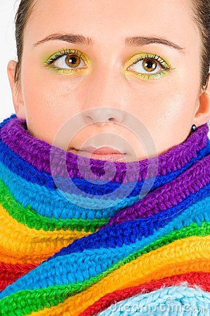 Beautiful young girl with colored scarf