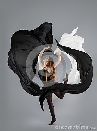 Free Beautiful Young Girl Dancing. Black And White Fabric In Motion. Royalty Free Stock Photos - 84649498