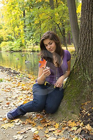 Beautiful young girl with dark hair in the park
