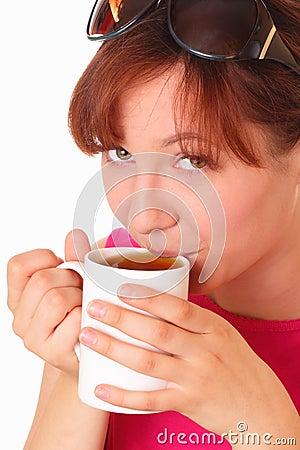 Beautiful young girl drinking tea