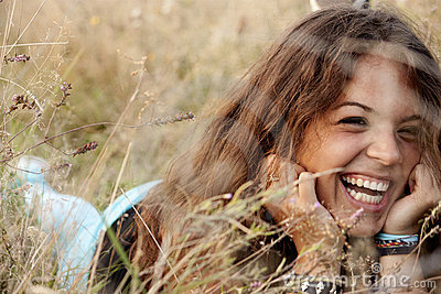 Beautiful young girl in a field