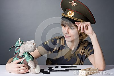 Beautiful young girl in form of Russian army