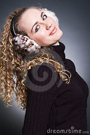 Beautiful young girl in fur headphones