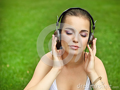 Beautiful young girl with headphones