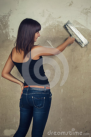 Beautiful young girl holding spatula over grunge