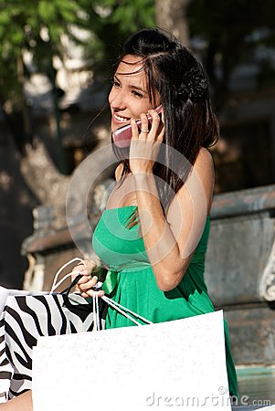 The beautiful young girl with phone