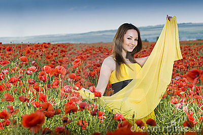 Beautiful young girl in the poppy field