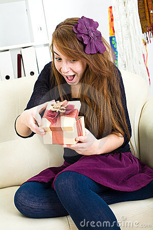 Beautiful young girl receives a gift