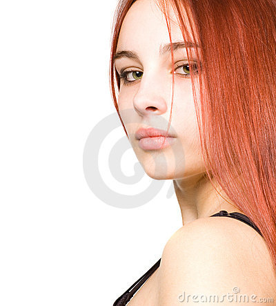 Beautiful young girl with red hair and green eyes