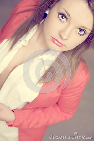 Beautiful young girl in red jacket
