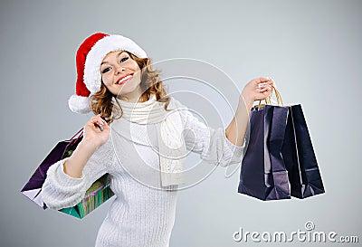 Beautiful young girl in Santa hat