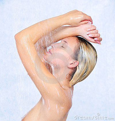 Beautiful young girl taking shower