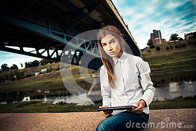 Beautiful young girl using digital tablet